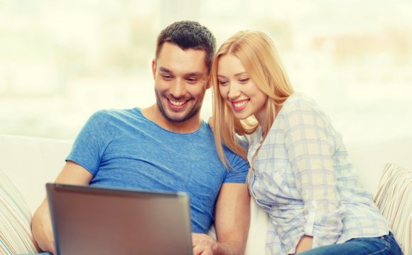 Couple with laptop at home